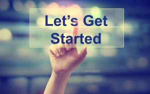 Let's Get Started concept with hand pressing a button